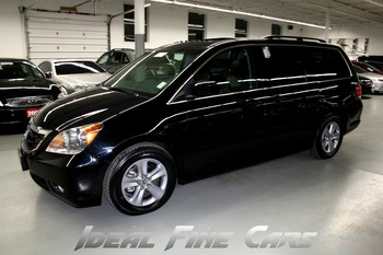 Image of a Black 2009 Honda Odyssey Touring Package